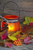 Autumn leaves with lantern abstract background Stock Photos