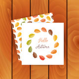 Autumn leaves made in wreath. Vector greeting cards on wood background. Autumn leaves made in wreath and monoline lettering. Seamless pattern with mushroom vector illustration