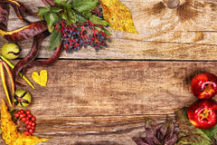 Autumn leaves on old wood Royalty Free Stock Photography