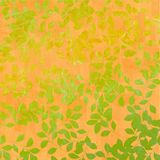 Autumn leaves on orange background. Gold and green Autumn leaves on orange background Royalty Free Stock Photography