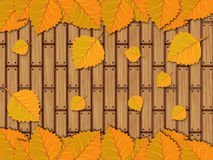 Autumn leaves over wooden planks Stock Image