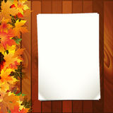 Autumn leaves and paper Royalty Free Stock Photos