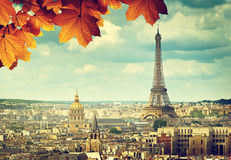 Autumn leaves in Paris and Eiffel tower Stock Photos