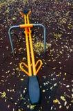 Autumn leaves on playground Stock Photos