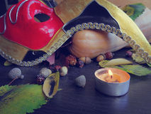 Autumn leaves, pumpkin and a mask with a candle Royalty Free Stock Images