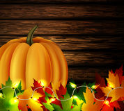 Autumn leaves and pumpkin on wooden texture Stock Photography