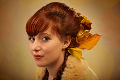 Autumn leaves and red hair portrait Royalty Free Stock Image