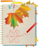 Autumn leaves in school notebook Stock Photography