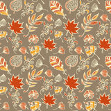 Autumn leaves vector seamless pattern. Botanic background in colors of orange, yellow, beige and grey. Warm hand drawn design texture in doodle style vector illustration