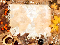 Autumn leaves on textured paper Royalty Free Stock Photography