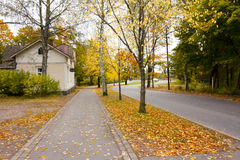 Autumn leaves on walkway in old museum district of Kouvola, Finland Stock Images