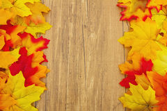 Autumn Leaves and Weather Wood Background Royalty Free Stock Image