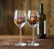 Autumn leaves in a wine glass and wine bottle on wooden table background Royalty Free Stock Photo