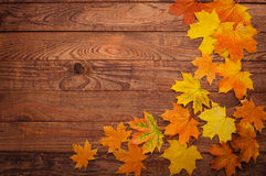 Autumn leaves on wooden table. Royalty Free Stock Image