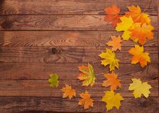 Autumn leaves on wooden table. Royalty Free Stock Photography