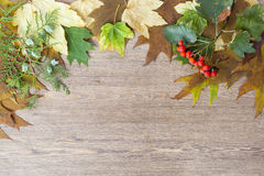 Autumn leaves yellowed wooden background close up Stock Photo