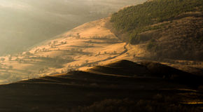 Autumn light falling on the hills Stock Image