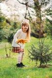 Autumn. Little Girl holding autumn leaves Stock Image