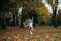 Autumn. Little Girl Playing autumn leaves Stock Photo