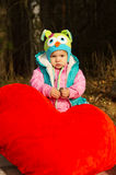 Autumn, the little girl with toy Stock Photos