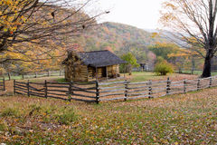 Autumn Log Cabin with Rail Fence Royalty Free Stock Photos