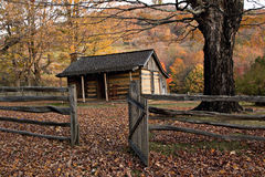 Autumn Log Cabin with Rail Fence Royalty Free Stock Photography
