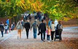 Autumn in London park, people and families walking and enjoying the weather Stock Photos