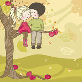 Autumn love. Boy and Girl sitting on a tree on autumn day Royalty Free Stock Photo