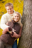 Autumn love couple hugging happy in park Royalty Free Stock Photos