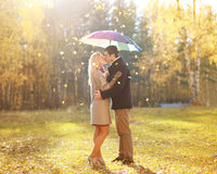 Autumn, love, relationship and people concept - kissing couple Stock Photos