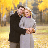 Autumn, love, relationships and people concept - happy couple Stock Photos