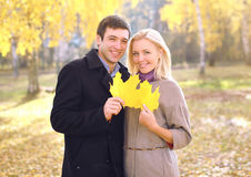 Autumn, love, relationships and people concept - portrait couple. Autumn, love, relationships and people concept - portrait pretty couple in sunny autumn park Stock Images