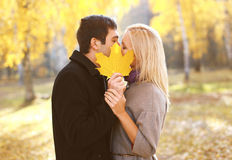 Autumn, love, relationships and people concept - pretty couple. Kissing in autumn park Stock Photo