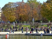 Autumn in the Luxembourg Garden. Luxembourg Garden. Cheerful smiling people - adults and children with parents enjoying sunny autumn day. Remembering Paris royalty free stock image