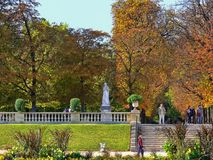 Autumn in the Luxembourg Garden. Luxembourg Garden. Cheerful smiling people - adults and children with parents enjoying sunny autumn day. Remembering Paris stock photo