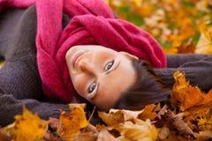 Autumn lying woman Stock Photos