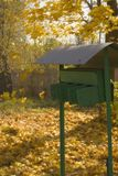 Autumn mail. Lightly yellow autumn park with mailboxes Royalty Free Stock Photos