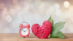 Autumn maple leaf and alarm clock Royalty Free Stock Image