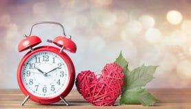 Autumn maple leaf and alarm clock Royalty Free Stock Photos
