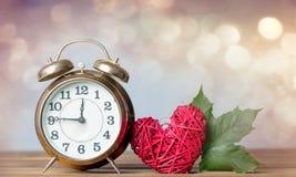 Autumn maple leaf and alarm clock Stock Images
