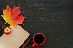 Autumn maple leaf, apple, cup of tea, paper for text and pencil Royalty Free Stock Photos