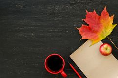 Autumn maple leaf, apple, cup of tea, paper for text and pencil Royalty Free Stock Photography