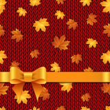 Autumn maple leaves on the knitted background Royalty Free Stock Photo