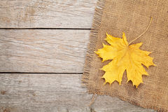 Autumn maple leaves over burlap texture background Royalty Free Stock Photos