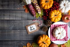 Autumn maple leaves with Pumpkin, apple, corn and red berries on old wooden background. Thanksgiving day concept royalty free stock images