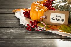 Autumn maple leaves with Pumpkin and red berries on old wooden b. Ackgound. Thanksgiving day concept stock image