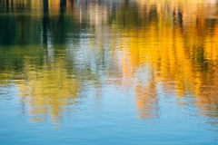 Autumn maple reflection in water at Gyeongbokgung Palace, Seoul, Korea stock images
