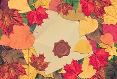 Autumn magnificent fantasy of nature. Farewell. Autumn marvelous colorful leaves frame with post envelope and vintage blank card inside. Red wax seal with word royalty free stock photography