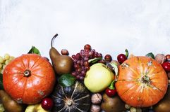 Autumn meal background with pumpkins, vegetables, fruits and nut. S, thanksgiving concept, top view royalty free stock images