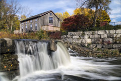 Autumn by the Mill. Abraham Erb's Grist Mill replica by the falls Royalty Free Stock Photography